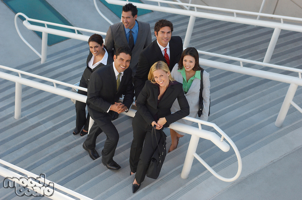Group portrait of business people on stairs, elevated view