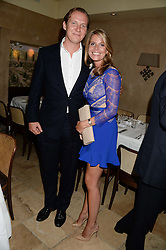 GEORGE CADBURY and his wife CATHERINE at an evening of Dinner & Dancing at Daphne's, 112 Draycott Avenue, London SW3 on 24th July 2013.