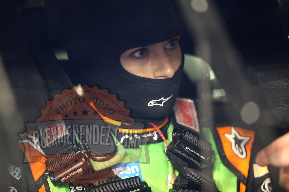 Race car driver Danica Patrick is seen inside the GoDaddy Chevrolet, prior to the NASCAR Sprint Unlimited Race at Daytona International Speedway on Saturday, February 15,  2014 in Daytona Beach, Florida.  (AP Photo/Alex Menendez)