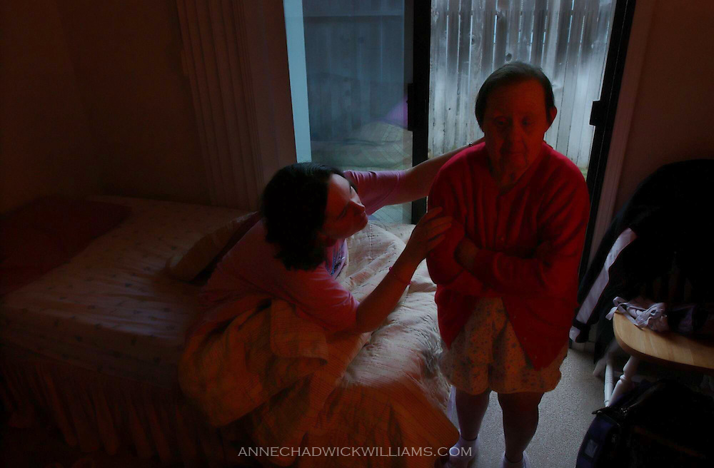 Terry Gordon reaches for her group home roommate Irene Pinole, who has Down Syndrome. The affection and words of love are repeated all day long. At 76, Irene Pinole, is one of the oldest living people with Down Syndrome. Anne Chadwick Williams / May 2004 / Sacramento Bee