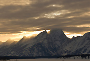The Tetons with clouds at sunset.  Grand Teton National Park.  Jackson Hole, Wyoming.