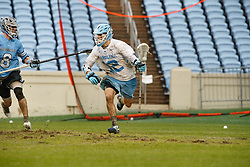 CHAPEL HILL, NC - FEBRUARY 23: Andy Matthews #12 of the North Carolina Tar Heels during a game against the Johns Hopkins Blue Jays on February 23, 2019 at Kenan Stadium in Chapel Hill, North Carolina. Hopkins won 11-10. (Photo by Peyton Williams/US Lacrosse)
