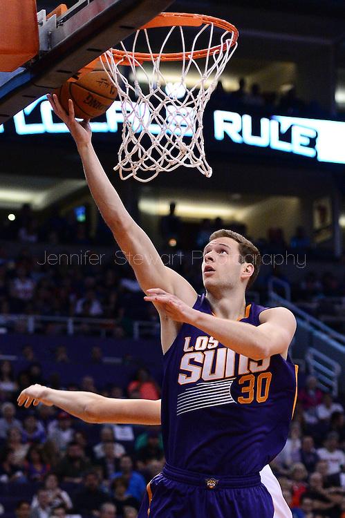 Mar 9, 2016; Phoenix, AZ, USA; Phoenix Suns forward Jon Leuer (30) lays up the ball in the first half of the game against the New York Knicks at Talking Stick Resort Arena. Mandatory Credit: Jennifer Stewart-USA TODAY Sports
