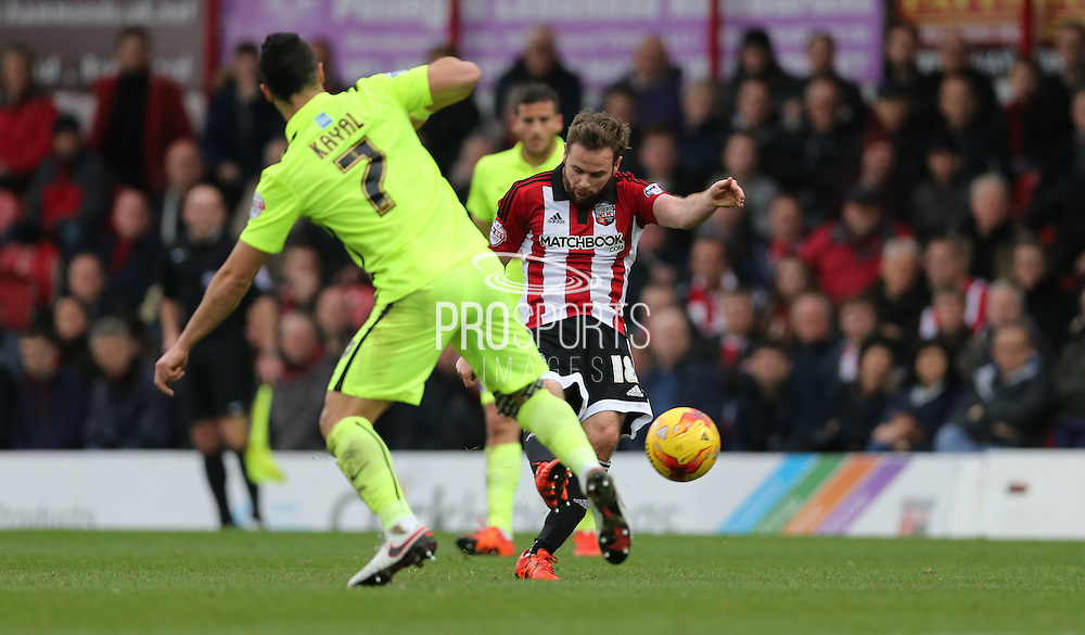 Brentford midfielder Alan Judge rifles in a shot during the Sky Bet Championship match between Brentford and Brighton and Hove Albion at Griffin Park, London, England on 26 December 2015.