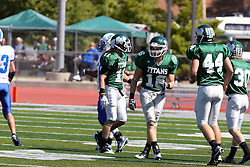 17 September 2011: Erich Bushong and Bret Swango walk off the field after a punt reception during an NCAA Division 3 football game between the Aurora Spartans and the Illinois Wesleyan Titans on Wilder Field inside Tucci Stadium in.Bloomington Illinois.