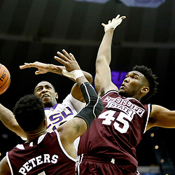 Jan 7, 2017; Baton Rouge, LA, USA; LSU Tigers guard Branden Jenkins (10) shoots over Mississippi State Bulldogs center E.J. Datcher (45) and guard Lamar Peters (1) during the second half of a game at the Pete Maravich Assembly Center. LSU defeated Mississippi State 95-78. Mandatory Credit: Derick E. Hingle-USA TODAY Sports