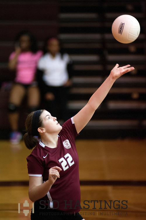 29 SEPT. 2015 -- ST. LOUIS -- Trinity Catholic High School volleyball players Abby Grumich (22) serves during the Titans' match with Cardinal Ritter College Prep at Cardinal Ritter in St. Louis Tuesday, Sept. 29, 2015.  The Titans won, 2-0, raising their record to 13-7 on the season. Photo © copyright 2015 Sid Hastings.