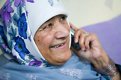 Older woman chatting on the telephone,