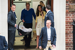 © London News Pictures. 02/05/2015. Catherine Duchess of Cambridge and Prince William leave the Lindo Wing of St Mary's hospital in London holding their new born baby daughter, Princess of Cambridge. Photo credit: Ben Cawthra /LNP