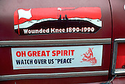 Native American (AIM) bumper sticker at Fort Snelling State Park Pow Wow.  Mendota Heights Minnesota USA