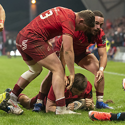 March 23, 2019 - Limerick, Ireland - Rhys Marshall of Munster celebrates scoring with teammates Dan Goggin and JJ Hanrahan during the Guinness PRO14 match between Munster Rugby and Zebre at Thomond Park Stadium in Limerick, Ireland on March 23, 2019  (Credit Image: © Andrew Surma/NurPhoto via ZUMA Press)