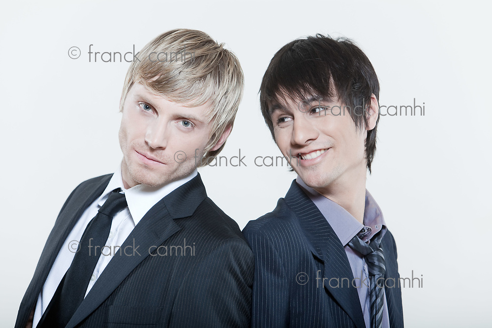 two male expressive young men on isolated background