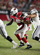 Arizona Cardinals nose tackle Rodney Gunter (95) tries to break free from a block during the 2016 NFL preseason football game against the Oakland Raiders on Friday, Aug. 12, 2016 in Glendale, Ariz. The Raiders won the game 31-10. (©Paul Anthony Spinelli)
