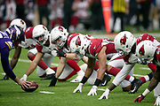 The Minnesota Vikings offensive line gets set to snap the ball at the line of scrimmage opposite the Arizona Cardinals defensive line during the NFL week 6 regular season football game against the Arizona Cardinals on Sunday, Oct. 14, 2018 in Minneapolis. The Vikings won the game 27-17. (©Paul Anthony Spinelli)