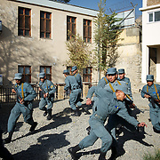 November 14, 2012 - Kabul, Afghanistan: Afghan National Police (ANP) cadets react to a simulated attack by Taliban during combat exercises at the Afghan Nacional Police Academy...ANP Academy trains 1250 cadets at the time during a period of four years. Every year, five hundred new recruits are selected, out of more than nine thousand of candidates, to join the academy and other five hundred graduate. Fifteen per cent of the recruits are women. (Paulo Nunes dos Santos/Polaris)