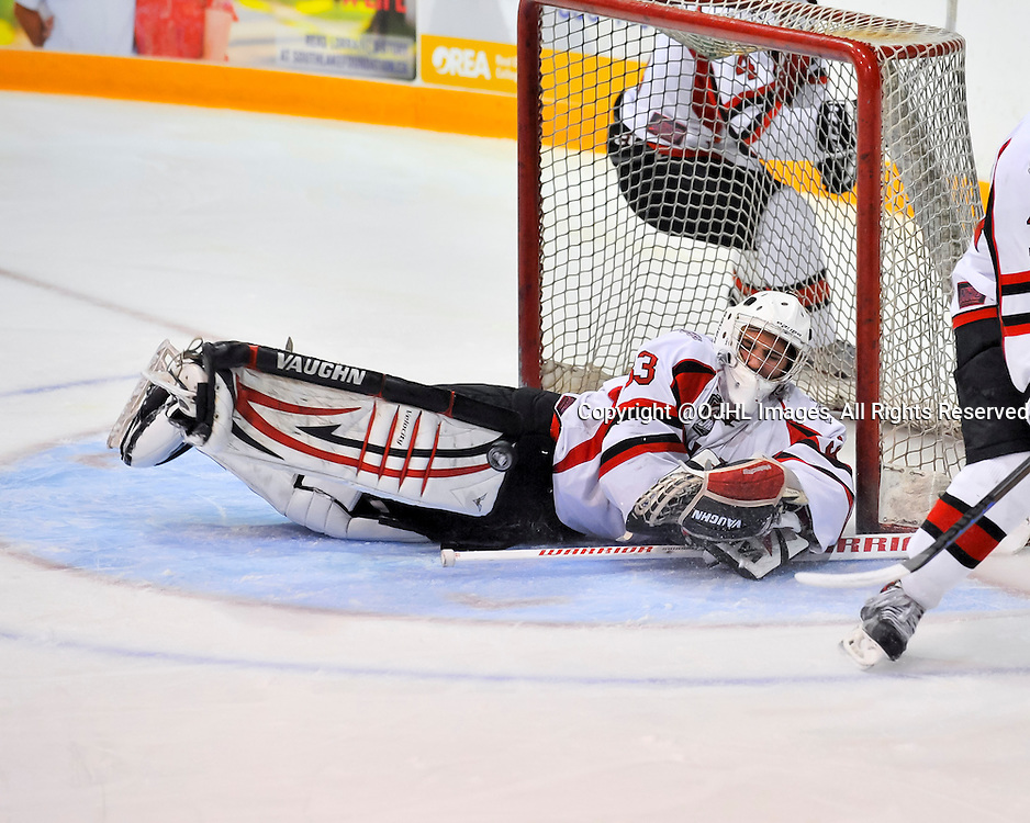NEWMARKET, ON - Sep 11, 2014 : Ontario Junior Hockey League game action between Stouffville and Newmarket,  Aaron Taylor #33 of the Stouffville Spirit Hockey Club makes the save.<br /> (Photo by Phillip Sutherland / OJHL Images)
