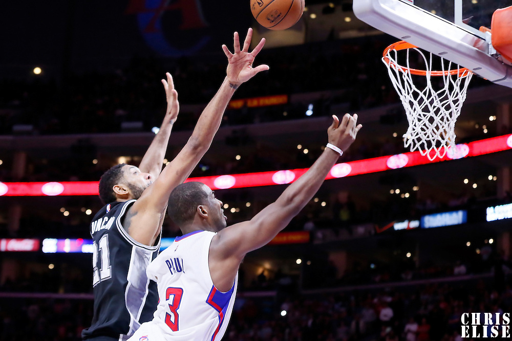 10 November 2014: Los Angeles Clippers guard Chris Paul (3) goes for the layup past San Antonio Spurs forward Tim Duncan (21) on the last possession during the San Antonio Spurs 89-85 victory over the Los Angeles Clippers, at the Staples Center, Los Angeles, California, USA.