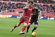 Middlesbrough FC defender Fernando Amorebieta (5) in action shadowed by Nottingham Forest forward Jamie Ward (19)during the Sky Bet Championship match between Middlesbrough and Nottingham Forest at the Riverside Stadium, Middlesbrough, England on 23 January 2016. Photo by George Ledger.