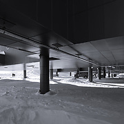 The bottom side of the Amundsen-Scott South Pole Station. The building was designed so that the prevailing winds would scour the snow from under the station building, and it seems to work, with large drifts building up on either side of the station but not under.