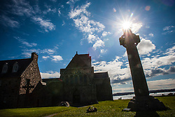 Ninth century St Martin's Cross, Iona Abbey..Iona is a small island in the Inner Hebrides off the western coast of Scotland. It was a centre of Irish monasticism for four centuries and is today renowned for its tranquility and natural beauty..©Michael Schofield..