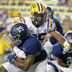 Aug 31, 2019; Baton Rouge, LA, USA; LSU Tigers linebacker Damone Clark (35) tackles Georgia Southern Eagles running back J.D. King (15) during the second half at Tiger Stadium. Mandatory Credit: Derick E. Hingle-USA TODAY Sports