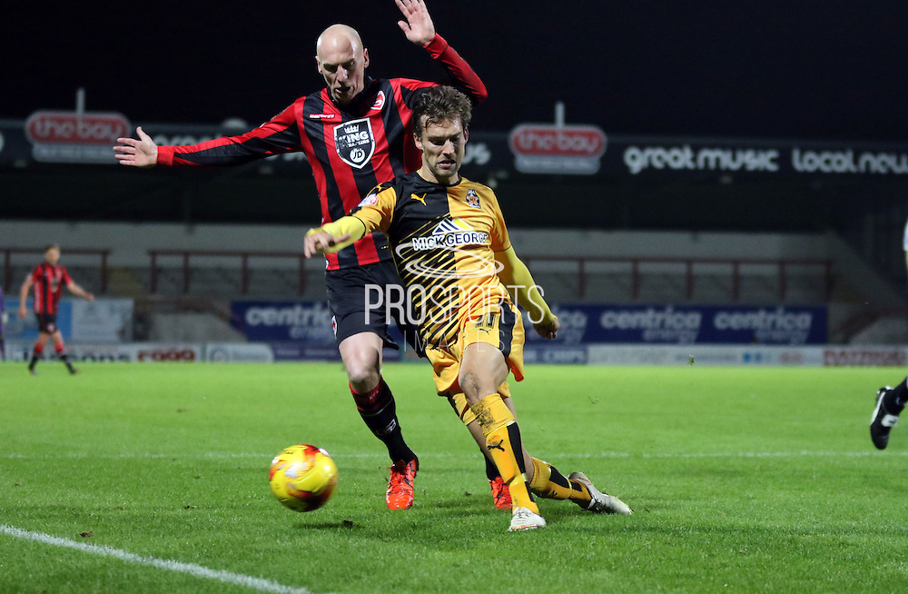 Kevin Ellison battles during the Sky Bet League 2 match between Morecambe and Cambridge United at the Globe Arena, Morecambe, England on 24 November 2015. Photo by Pete Burns.