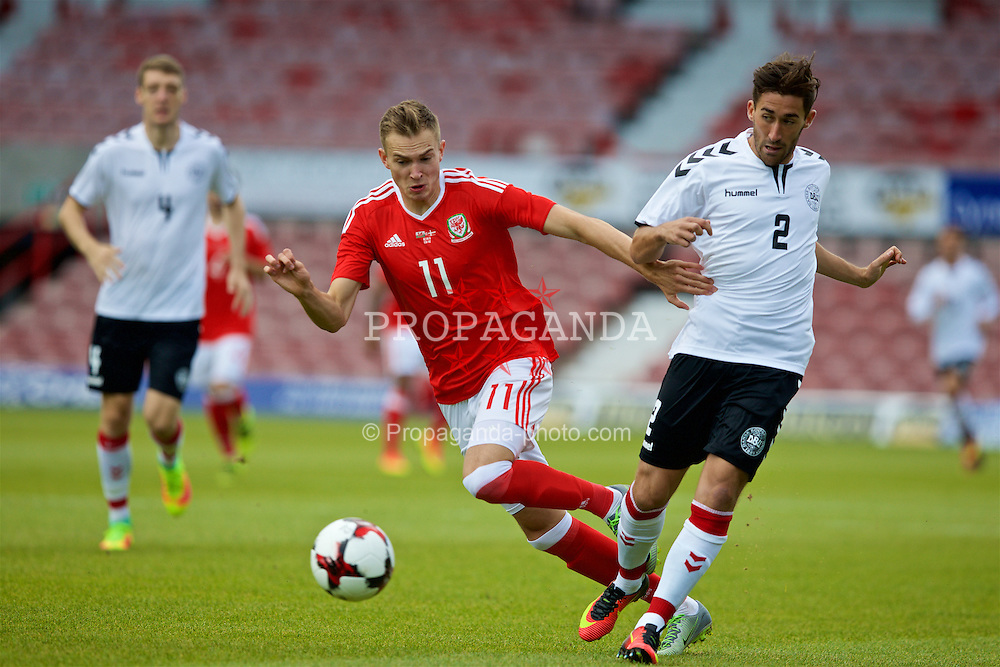 WREXHAM, WALES - Friday, September 2, 2016: Wales' Ryan Hedges in action against Denmark's Frederik Holst during the UEFA Under-21 Championship Qualifying Group 5 match at the Racecourse Ground. (Pic by Paul Greenwood/Propaganda)