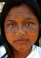 A Kichwa indian woman, with her face painted in their traditional way, in Sarayaku, a small Indian village deep in Ecuador's Amazon region on Sunday, October 26, 2003. The community of Sarayaku is against any attempt to look for oil on their territory. Nevertheless the Ecuadorian government and foreign oil companies are determined to explore for oil in Ecuador's Amazon region. (Photo/Scott Dalton)