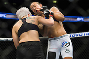 DALLAS, TX - MARCH 14:  Larissa Pacheco connects with a punch against Germaine de Randamie during UFC 185 at the American Airlines Center on March 14, 2015 in Dallas, Texas. (Photo by Cooper Neill/Zuffa LLC/Zuffa LLC via Getty Images) *** Local Caption *** Larissa Pacheco; Germaine de Randamie
