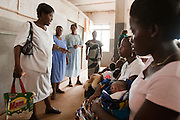 District matron Susan Charles addresses a group of mothers and their children sing at the beginning of an under-5 clinic at the Pujehun Government hospital in Pujehun, Sierra Leone on Friday March 19, 2010.