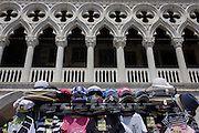 Tourist souvenirs on sale outside the Doge's Palace in Piazza San Marco, Venice, Italy