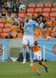 July 18, 2018 - Houston, TX, U.S. - HOUSTON, TX - JULY 18:  Sporting Kansas City forward Johnny Russell (7) heads the ball during the US Open Cup Quarterfinal soccer match between Sporting KC and Houston Dynamo on July 18, 2018 at BBVA Compass Stadium in Houston, Texas. (Photo by Leslie Plaza Johnson/Icon Sportswire) (Credit Image: © Leslie Plaza Johnson/Icon SMI via ZUMA Press)
