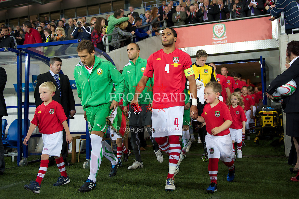 CARDIFF, WALES - Friday, October 8, 2010: Wales' captain Ashley Williams leads his side out to face Stiliyan Petrov's Bulgaria during the UEFA Euro 2012 Qualifying Group G match at the Cardiff City Stadium. (Pic by David Rawcliffe/Propaganda)