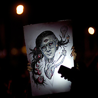 A fan displays a drawing of Skrillex as he performs during the Governors Ball Music Festival on Randall's Island in New York, NY on June 7, 2014.