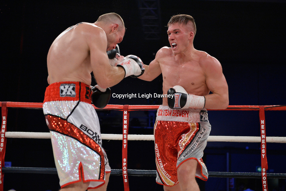 Nick Blackwell (right) defeats Nathan King in a middleweight boxing contest at Glow, Bluewater, Kent on the 8th November 2014. Promoter: Hennessy Sports. © Leigh Dawney Photography 2014.