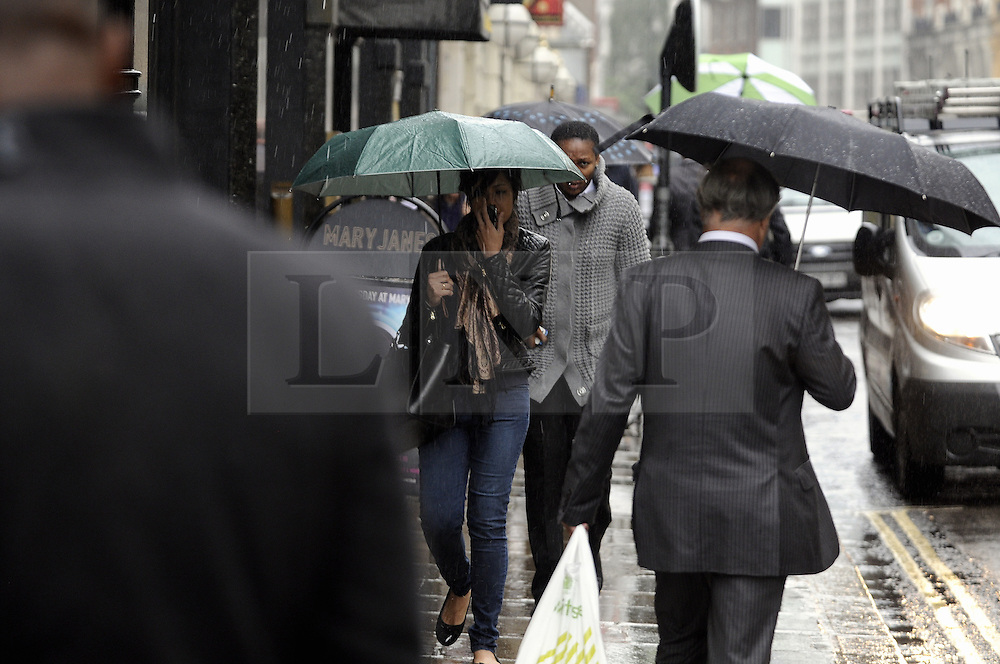 © Licensed to London News Pictures. 11/10/2013<br /> City workers get wet at lunch time.<br /> Wet rainy weather today (11.10.2013)  Minories, City Of London,EC3 <br /> Photo credit :Grant Falvey/LNP