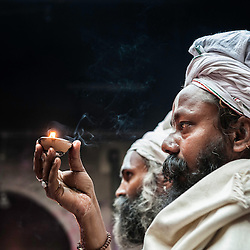 Sadhu inside a temple during the celebrations of Holi, Vrindavan, India