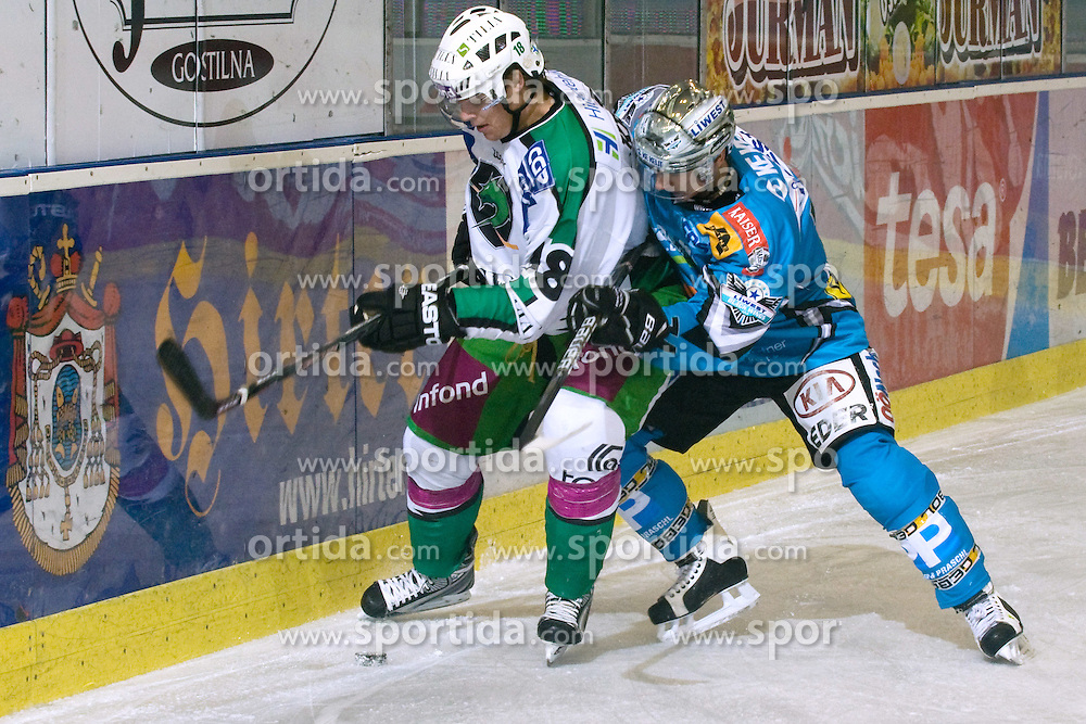 Jure Kralj (HDD Tilia Olimpija, #18) and Daniel Oberkofler ( EHC Liwest Black Wings Linz, #74) during ice-hockey match between HDD Tilia Olimpija and EHC Liwest Black Wings Linz in 18th Round of EBEL league, on November 5, 2010 at Hala Tivoli, Ljubljana, Slovenia. (Photo By Matic Klansek Velej / Sportida.com)