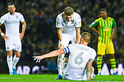 Leeds United defender Ezgjan Alioski (10) reacts to Leeds United defender Liam Cooper (6) injured during the EFL Sky Bet Championship match between Leeds United and West Bromwich Albion at Elland Road, Leeds, England on 1 October 2019.
