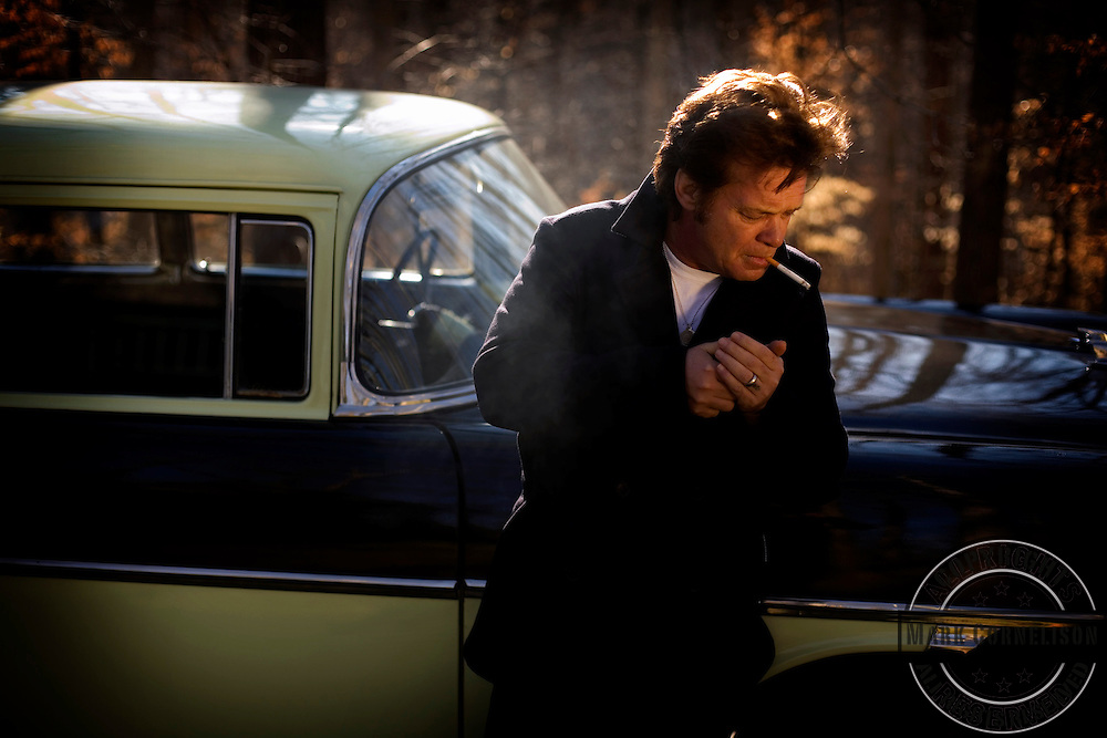 "John Mellencamp with his 1956 Chevrolet Nomad in Bloomington Indiana just before the release of his new album "" Freedom'.s Road""  on Friday January 19,2007. ©Mark Cornelison"