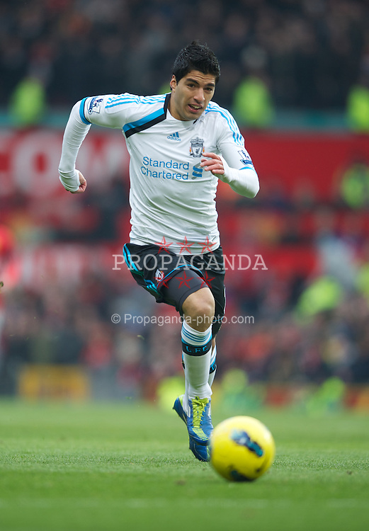 MANCHESTER, ENGLAND - Saturday, February 11, 2012: Liverpool's Luis Alberto Suarez Diaz in action against Manchester United during the Premiership match at Old Trafford. (Pic by David Rawcliffe/Propaganda)