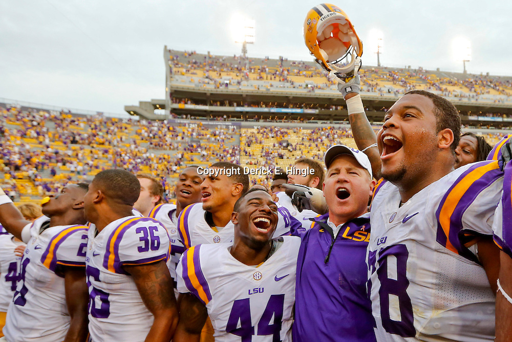 Oct 12, 2013; Baton Rouge, LA, USA; LSU Tigers head coach Les Miles with defensive back Tre' Sullivan (44) and offensive tackle Vadal Alexander (78) following win over the Florida Gators at Tiger Stadium. LSU defeated Florida 17-6. Mandatory Credit: Derick E. Hingle-USA TODAY Sports