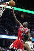 April 8, 2011; Cleveland, OH, USA; Chicago Bulls small forward Luol Deng (9) lays in a shoot over Cleveland Cavaliers point guard Baron Davis (85) during the third quarter at Quicken Loans Arena. The Bulls beat the Cavaliers 93-82. Mandatory Credit: Jason Miller-US PRESSWIRE