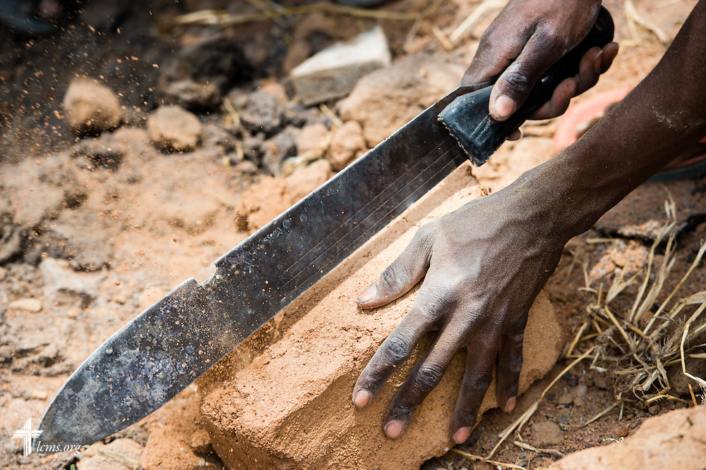 A church member helps construct the Magagi Lutheran Church of the Evangelical Lutheran Church in Tanzania – South-East of Lake Victoria Diocese (ELCT-SELVD) on Friday, March 13, 2015, in Shinyanga region, Tanzania. Funds are needed to purchase a tin roof for the church. LCMS Communications/Erik M. Lunsford