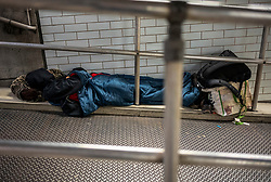 FILE IMAGE © Licensed to London News Pictures. 21/10/2019. London, UK. A homeless man sleeps in-between railings in a makeshift home in Westminster tube Station and less than 100 yards from the Houses of Parliament. Pictures highlight the reality of homelessness in Westminster taken during the build up of Brexit and the General election just a few hundreds yards from Parliament and Downing Street. Photo credit: Alex Lentati/LNP