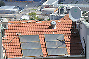 Solar water heater collectors on a roof. Photographed in Haifa, Israel