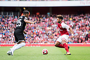 Arsenal midfielder Alex Oxlade-Chamberlain (15) and Gabriel Mercado (25) during the Emirates Cup 2017 match between Arsenal and Sevilla at the Emirates Stadium, London, England on 30 July 2017. Photo by Sebastian Frej.