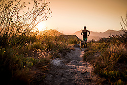 Sunset trail running and yoga on Elsies Peak overlooking False Bay, near Fish Hoek, Cape Town, South Africa, RSA