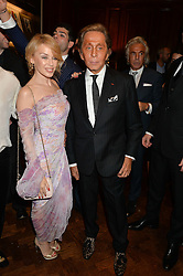 KYLIE MINOGUE and VALENTINO GARAVANI at a party to celebrate the launch of the Maison Assouline Flagship Store at 196a Piccadilly, London on 28th October 2014.  During the evening Valentino signed copies of his new book - At The Emperor's Table.