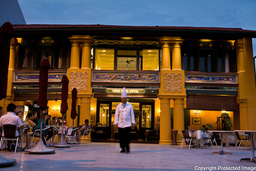 historic facade of Yeng Keng Hotel with the hotel's chef